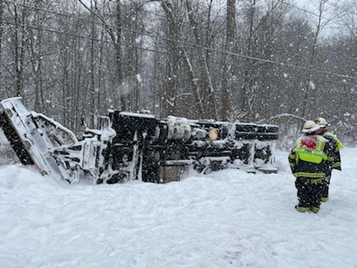 A town snowplow truck overturned on Fort Edward Road on Thursday, Dec. 17, 2020.