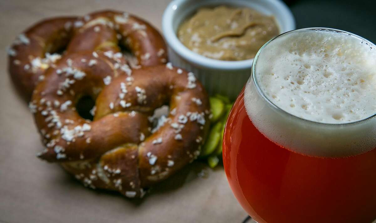 The Hangar 24 Hullabaloo beer with a pretzel at Steins Beer Garden in Mountain View.