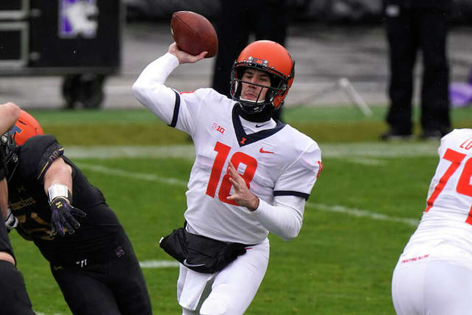 University of Illinois quarterback Brandon Peters throws a pass against Northwestern last week in Evanston. The Illini will play at Penn State Saturday. Photo: Associated Press
