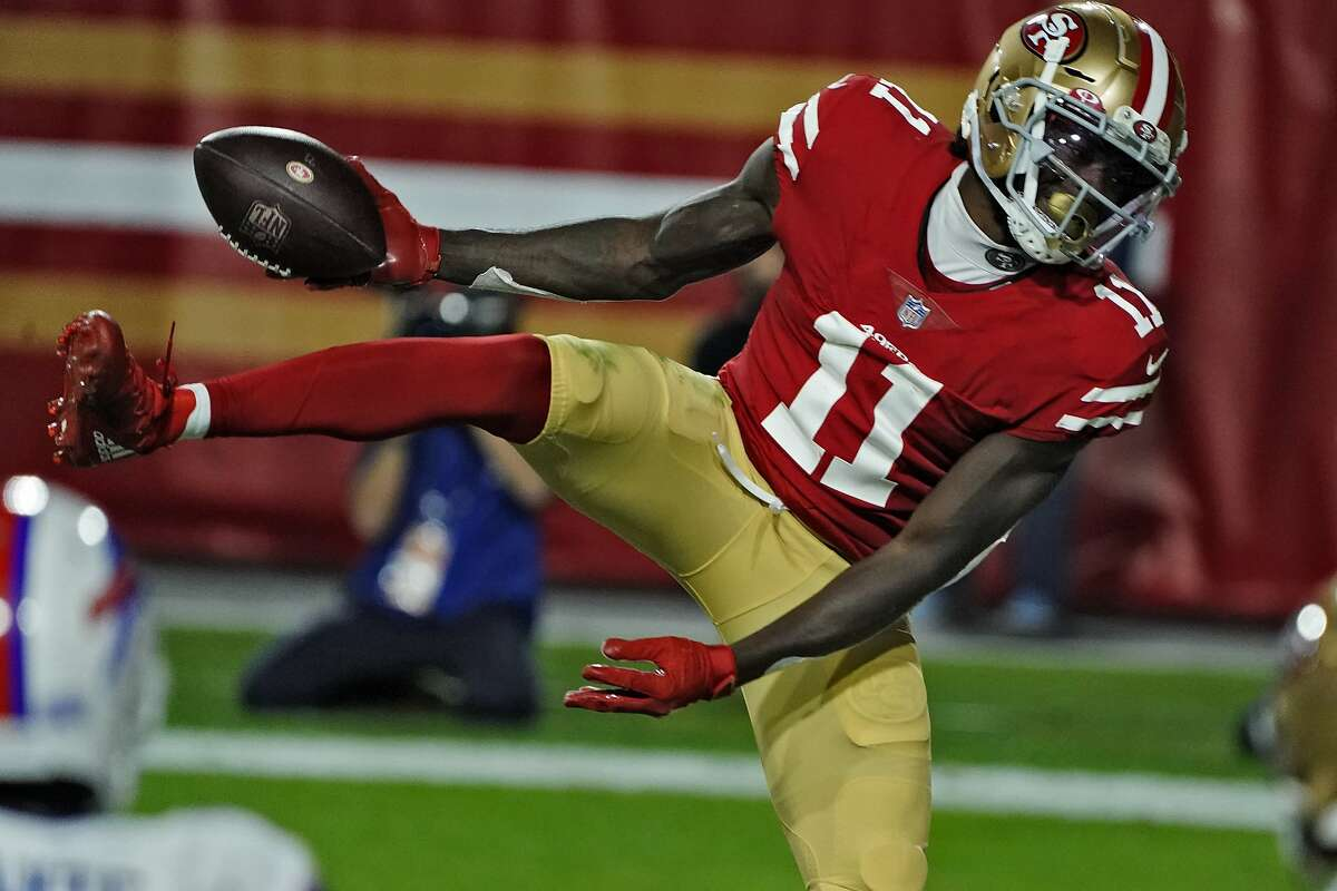 San Francisco 49ers wide receiver Brandon Aiyuk (11) celebrates his touchdown catch against the Buffalo Bills during the first half of an NFL football game, Monday, Dec. 7, 2020, in Glendale, Ariz. (AP Photo/Rick Scuteri)