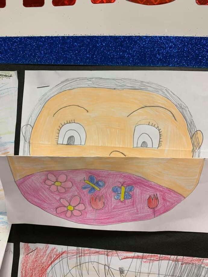 Elementary students at Manistee Catholic Central made fold-out self-portraits that displayed their faces both with and without a mask. Photo: Courtesy Photo