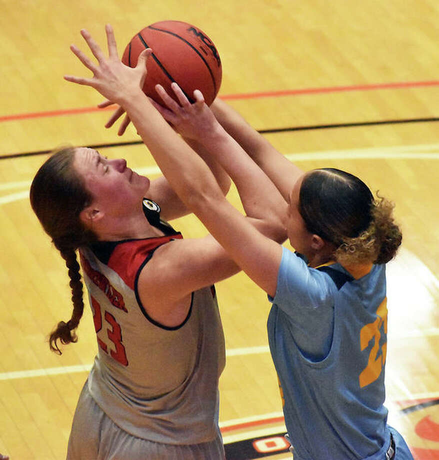 SIUE forward Allie Troeckler is fouled as she goes up for a shot in a game against the University of Missouri-Kansas City inside First Community Arena in Edwardsville. Photo: Matt Kamp|The Intelligencer
