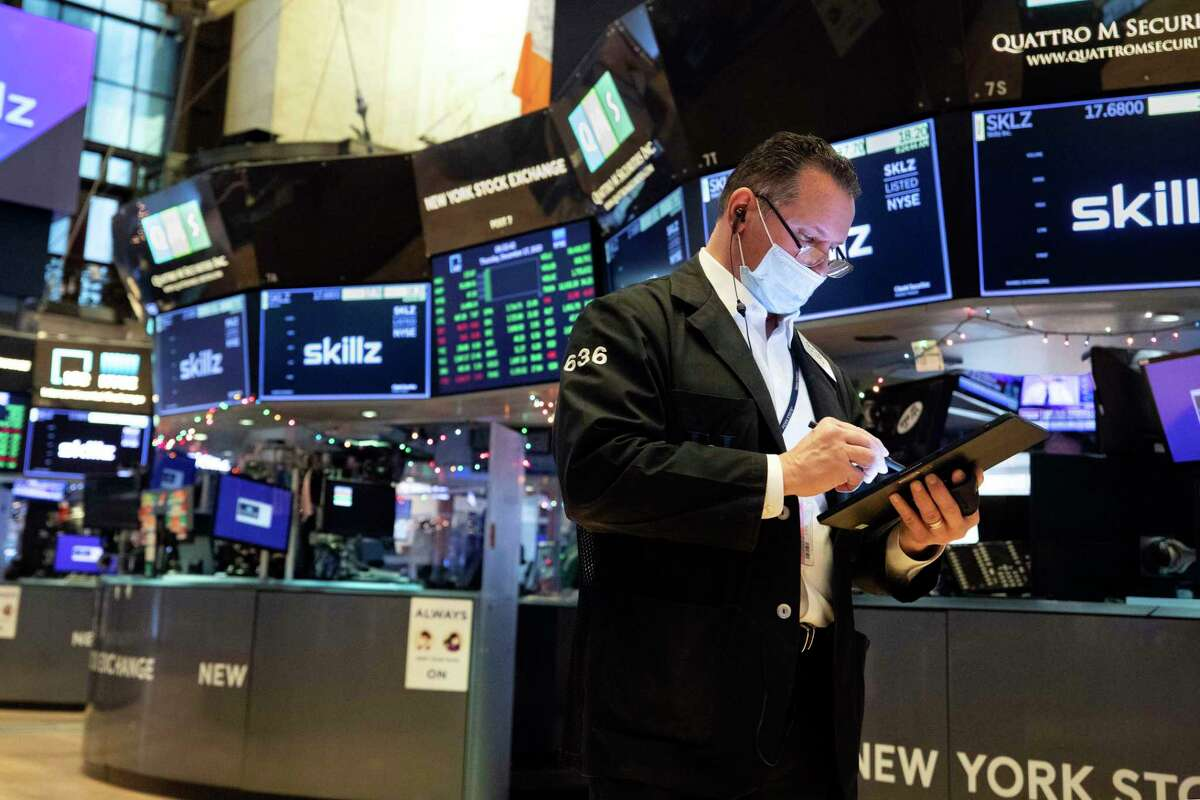 In this photo provided by the New York Stock Exchange, trader Edward Curran works on the floor, Thursday, Dec. 17, 2020.