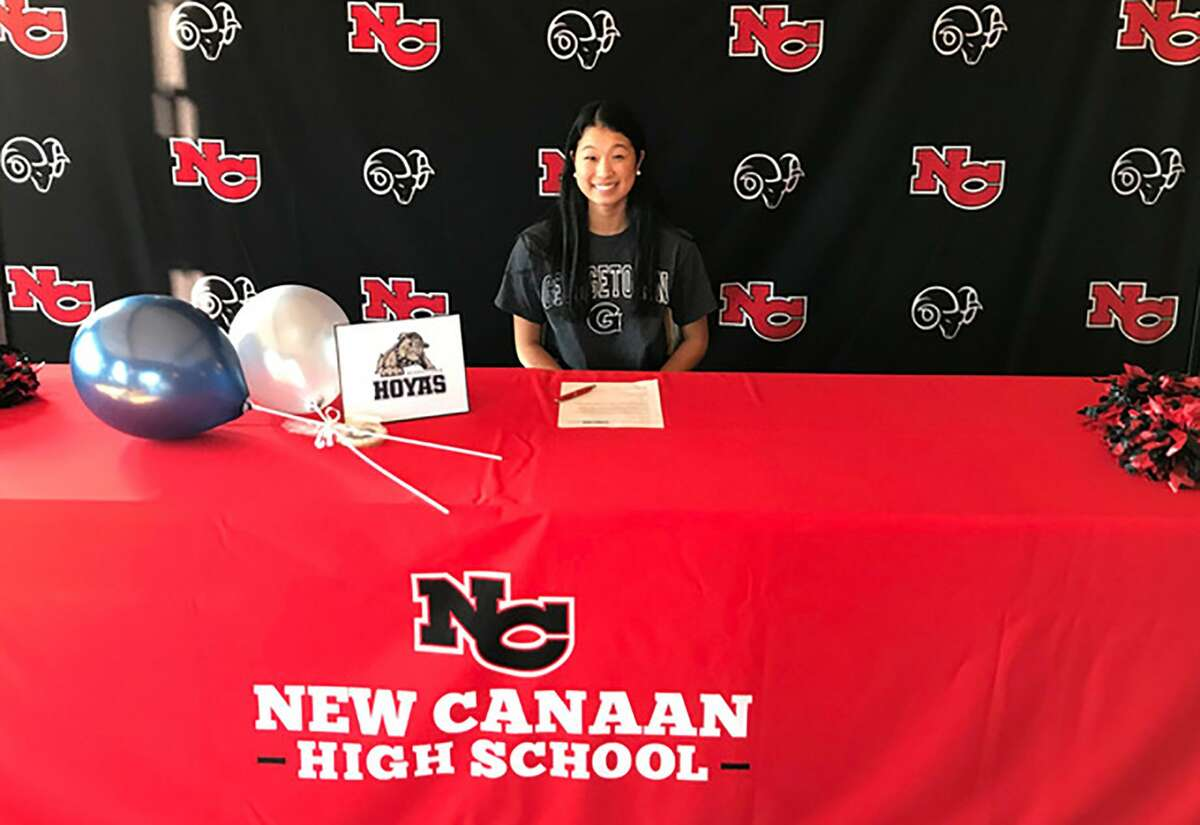 New Canaan's Maddie Haley signed her National Letter of Intent to the Georgetown swim team during the Rams' National Signing Day event at Waveny House on Monday.