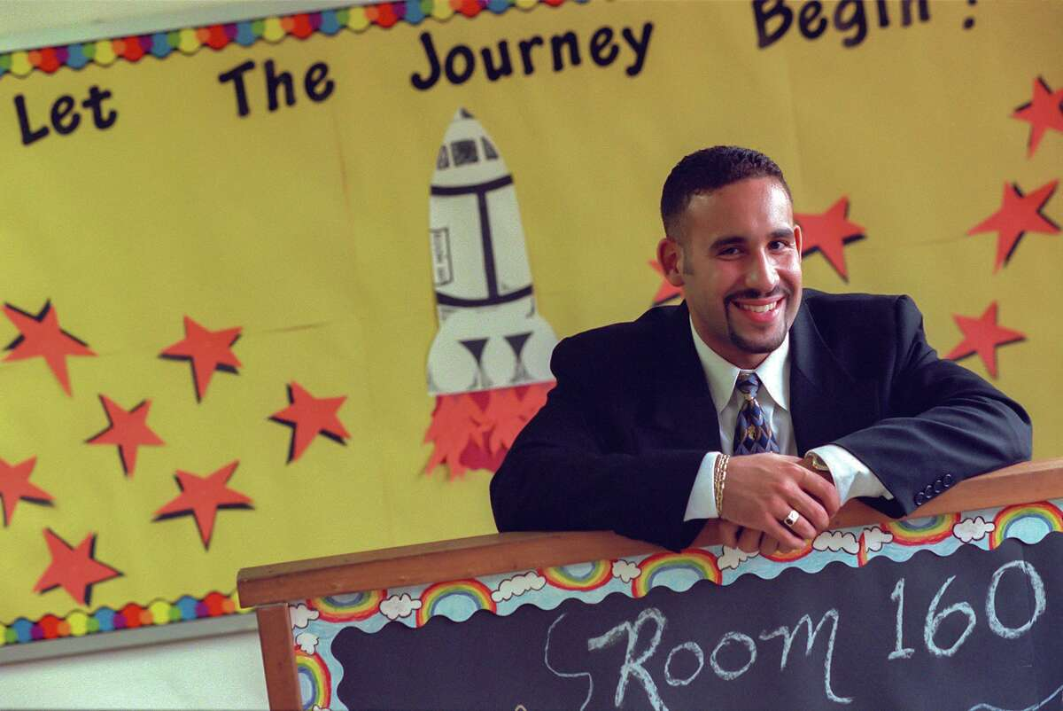 In this photo from August 1998, Miguel Cardona is ready to start his first year teaching in his fourth-grade classroom at Israel Putnam School.