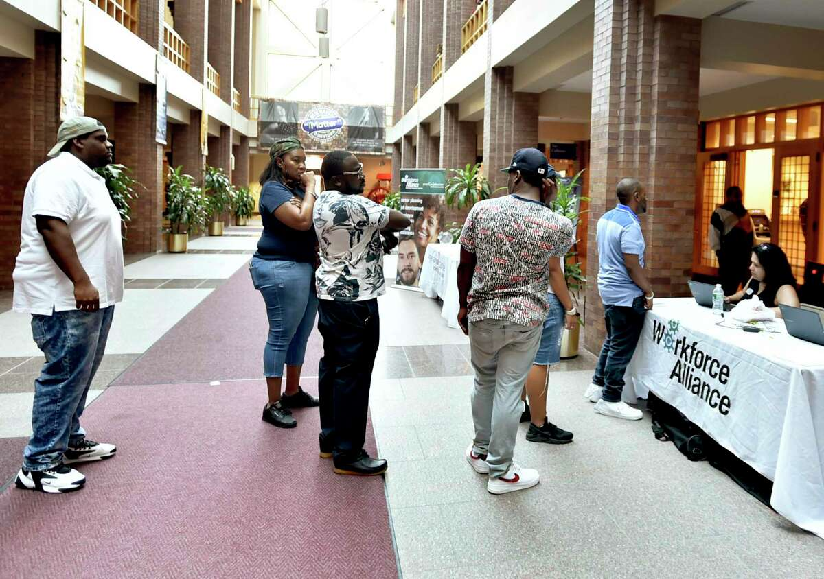 People line up to register for interviews for positions at Amazon's North Haven location at a job fait in New Haven in 2019.
