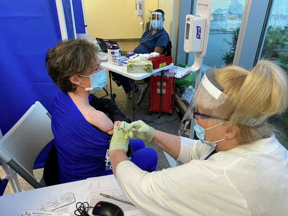 Tami Baly, an emergency room nurse at Houston Methodist The Woodlands Hospital was one of the first frontline healthcare workers to get the COVID-19 vaccination. COVID-related deaths increased by two Thursday as Montgomery County added 234 cases with 106 new active cases. Photo: Courtesy