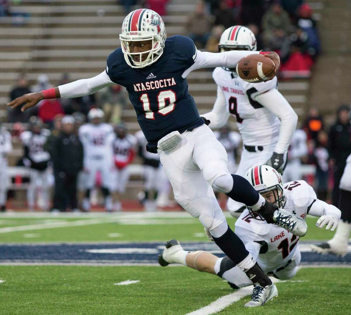 Eagles quarterback Greg Campbell breaks up the field during Atascocita's 16-41 loss to Lake Travis on Nov. 23, 2013, at Merrill Green Stadium in Bryan, TX.