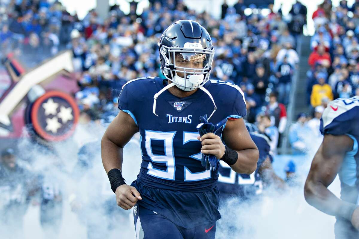 NASHVILLE, TN - NOVEMBER 24: Reggie Gilbert #93 of the Tennessee Titans jogs onto the field before a game against the Jacksonville Jaguars at Nissan Stadium on November 24, 2019 in Nashville, Tennessee. The Titans defeated the Jaguars 42-20. (Photo by Wesley Hitt/Getty Images)