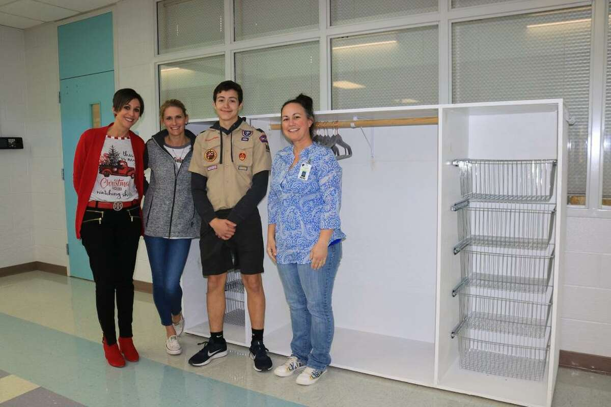 Ethan Cooper, 16, built a lost-and-found cabinet for his alma mater, Challenger Elementary School for his Boy Scout Eagle project. With him are Challenger Principal Becky Morris, Assistant Principal Stacie Muras and former Challenger librarian Jenni Murphy.