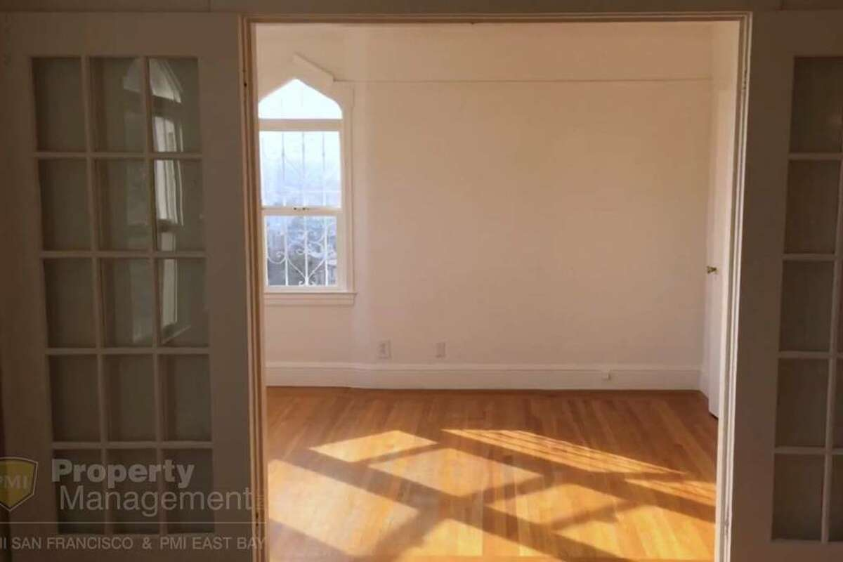 There are real hardwood floors throughout the upstairs living area, the listing says.