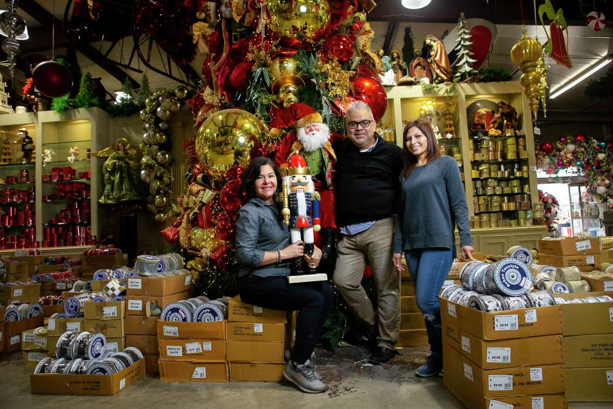 Designers Tina Rubio, Michael Segura and Marcela Alas at Craftex, a decoration supply store in Houston on Monday, Dec. 14, 2020.