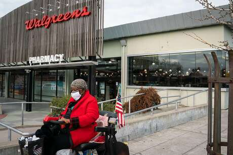 Althea Rankins, 71, leaves after shopping at a Walgreens store that could undergo redevelopment as part of the city's rezoning plan on Adeline Street in Berkeley, Calif., on Tuesday, Dec. 15, 2020.