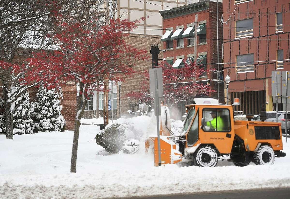 Snow removal on Howe Avenue in Shelton, Conn. on Thursday, December 17, 2020.