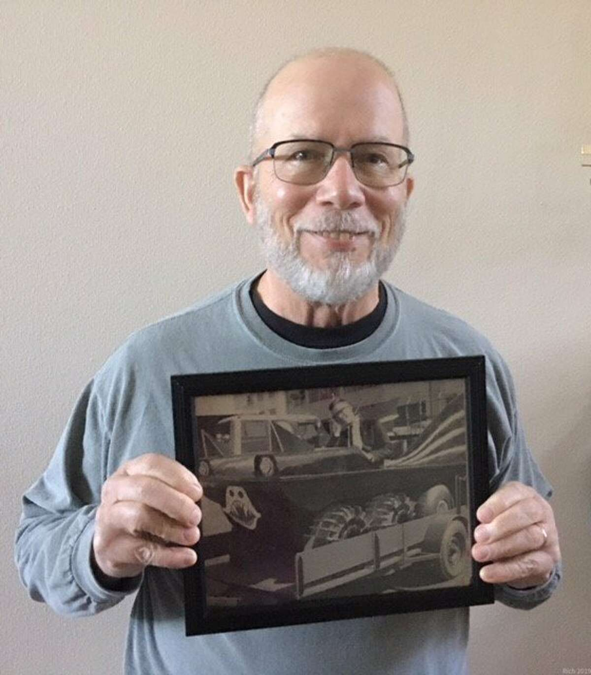 Rich Morse holding the Chronicle photo of him in the Batmobile, 2020