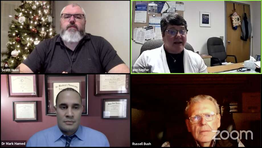 The Tribune's Live COVID Q&A Forum on Dec. 17 features Huron County Health Department Medical Director Dr. Mark Hamed, Public Health Officer Ann Hepfer and Chief Medical Examiner Russell Bush. The forum is moderated by Assistant Editor Scott Nunn. Photo: Screenshot Of Huron Daily Tribune Video