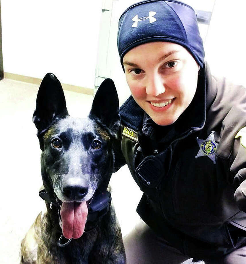 Madison County deputy Brianna Markel and her partner, K9 officer Jada, a 7-year-old Dutch Shepherd. Markel is a former standout Roxana High softball and hockey player, who went on to play softball at Lewis and Clark Community College and Blackburn College. Photo: For The Telegraph