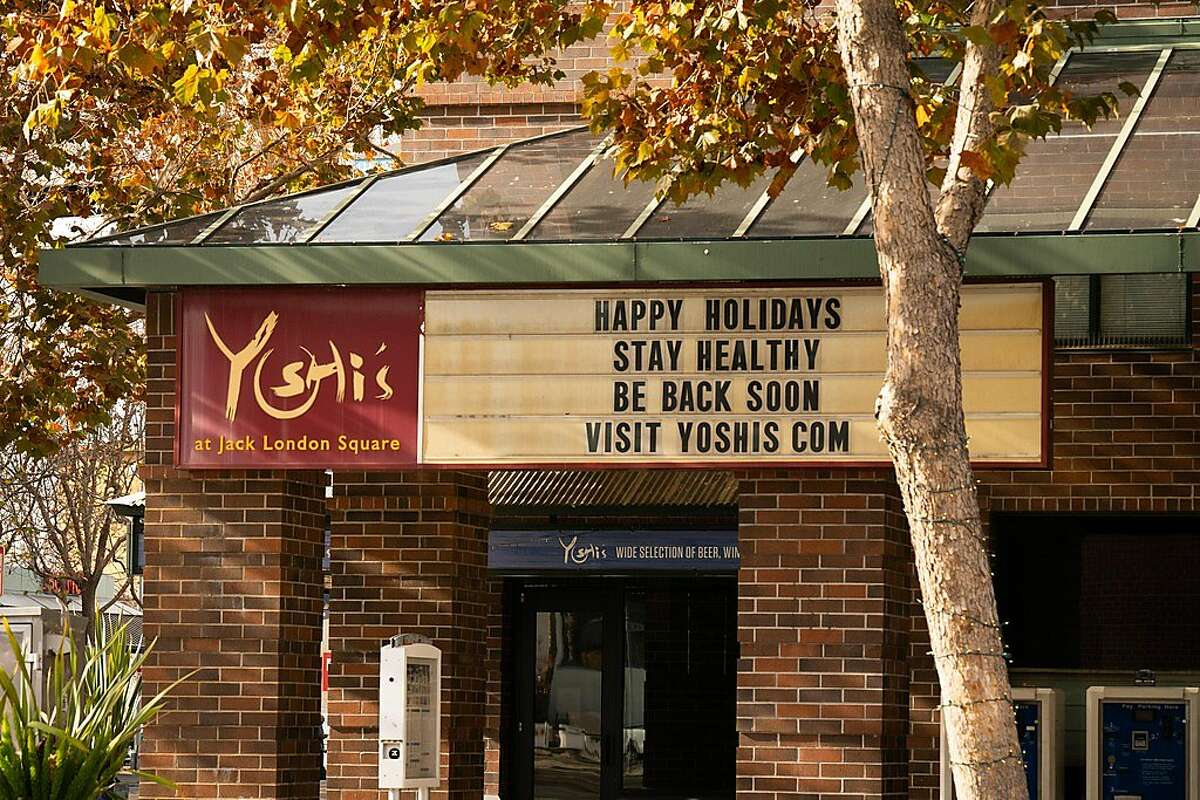 A sign is seen outside of Yoshi's in Oakland, Calif., on Tuesday, Dec. 15, 2020. The restaurant and jazz club has been temporarily closed for nearly nine months due to the coronavirus pandemic.