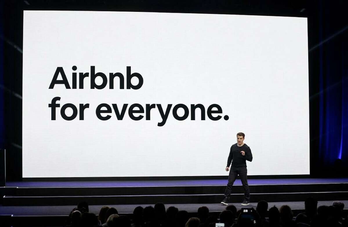 In this Feb. 22, 2018, file photo, Airbnb co-founder and CEO Brian Chesky speaks during an event in San Francisco. Airbnb hopes to raise as much as $2.6 billion in its initial public stock offering this month, betting investors will see its home-sharing model as the future of travel. In a government filing Tuesday, Dec. 1, 2020, the San Francisco-based company said it expects to offer 51.9 million common shares priced between $44 and $50 per share.