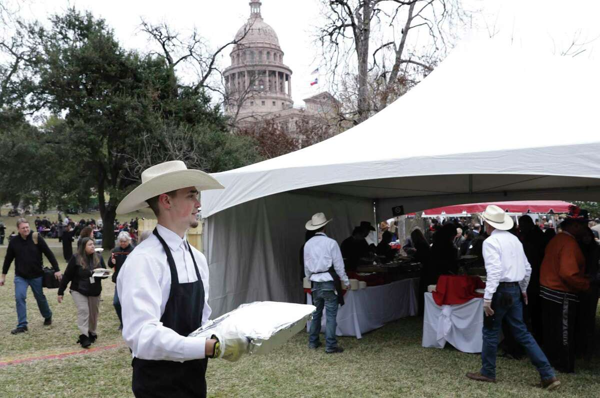 Another tray of barbecue arrives at the Inaugural Family Barbecue on the South Grounds of the Texas Capitol after the Inauguration Ceremony in Austin, on Tuesday, Jan. 15, 2019.