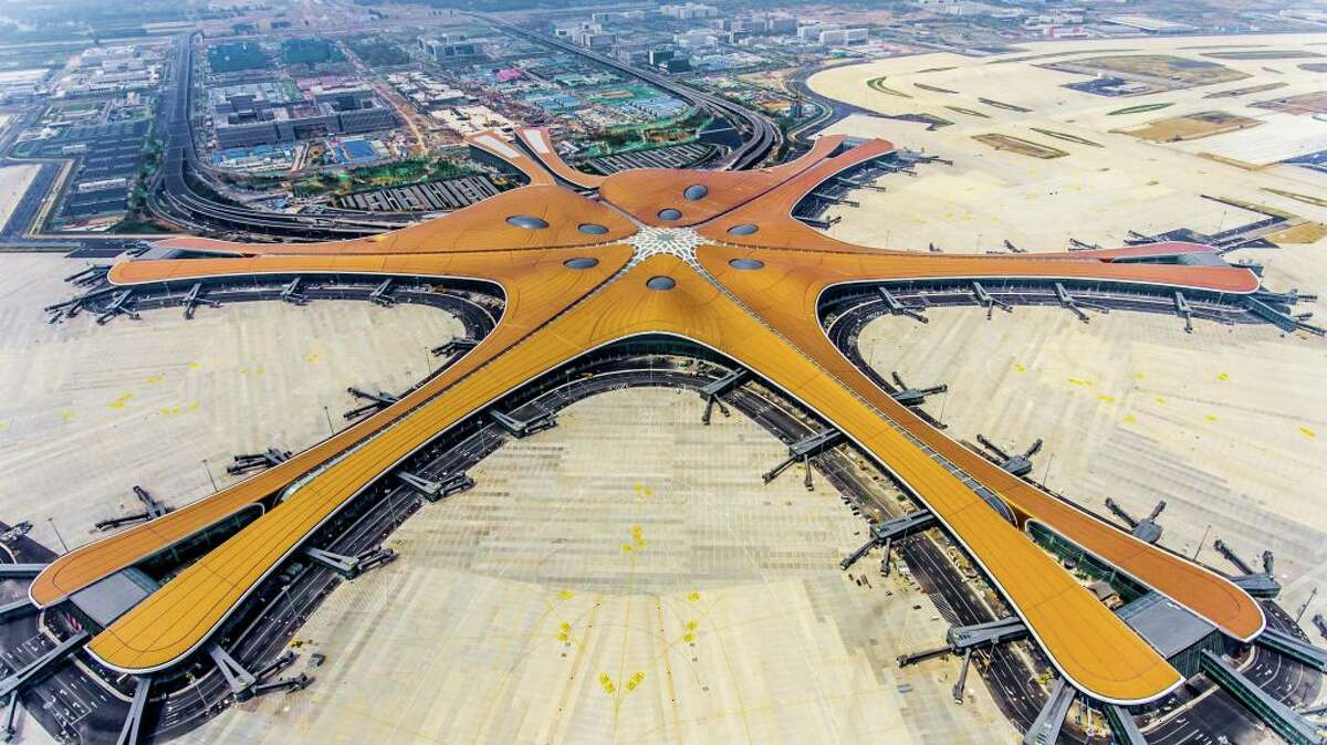 This photo taken on June 28, 2019 shows the terminal of the new Beijing Daxing International Airport. - an eye-catching multi-billion dollar airport resembling a massive shining starfish, to accommodate soaring air traffic in China and celebrate the Communist government's 70th anniversary in power.