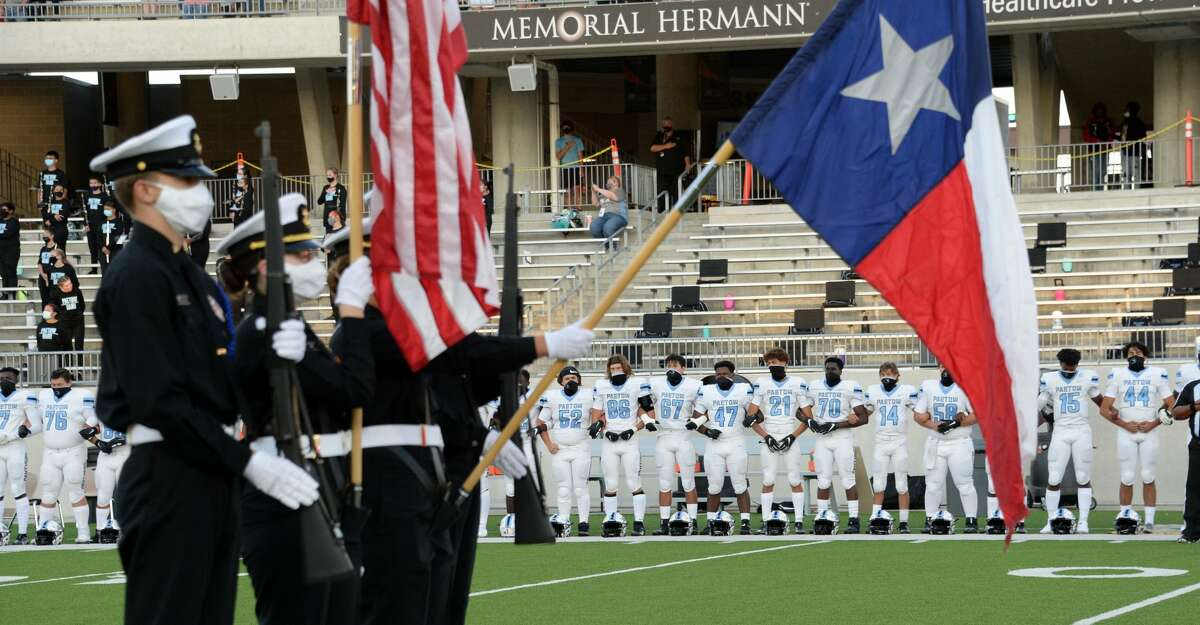 The Paetow Panthers stand and wear masks during the National Anthem before a non-conference football game with the Morton Ranch Mavericks on Friday, October 2, 2020 at Legacy Stadium, Katy, TX.