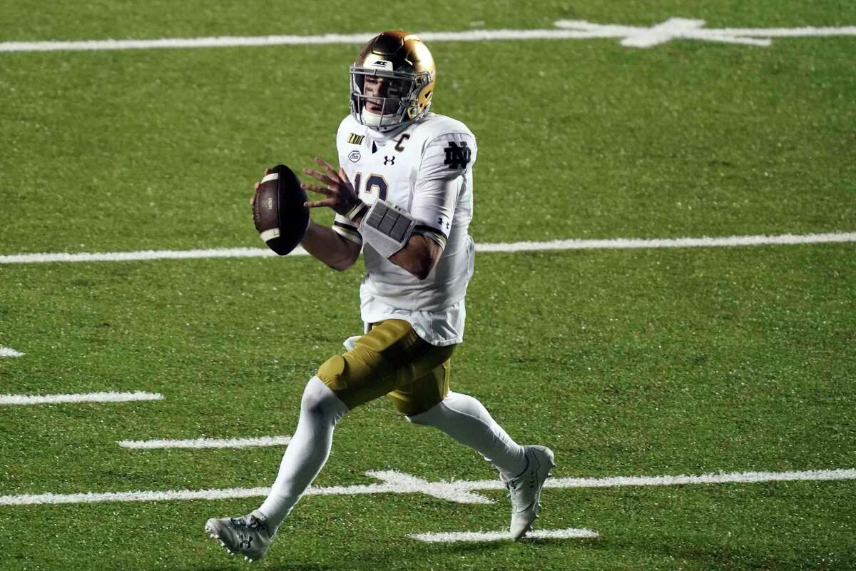 Notre Dame quarterback Ian Book looks to pass against North Carolina during a game last month.