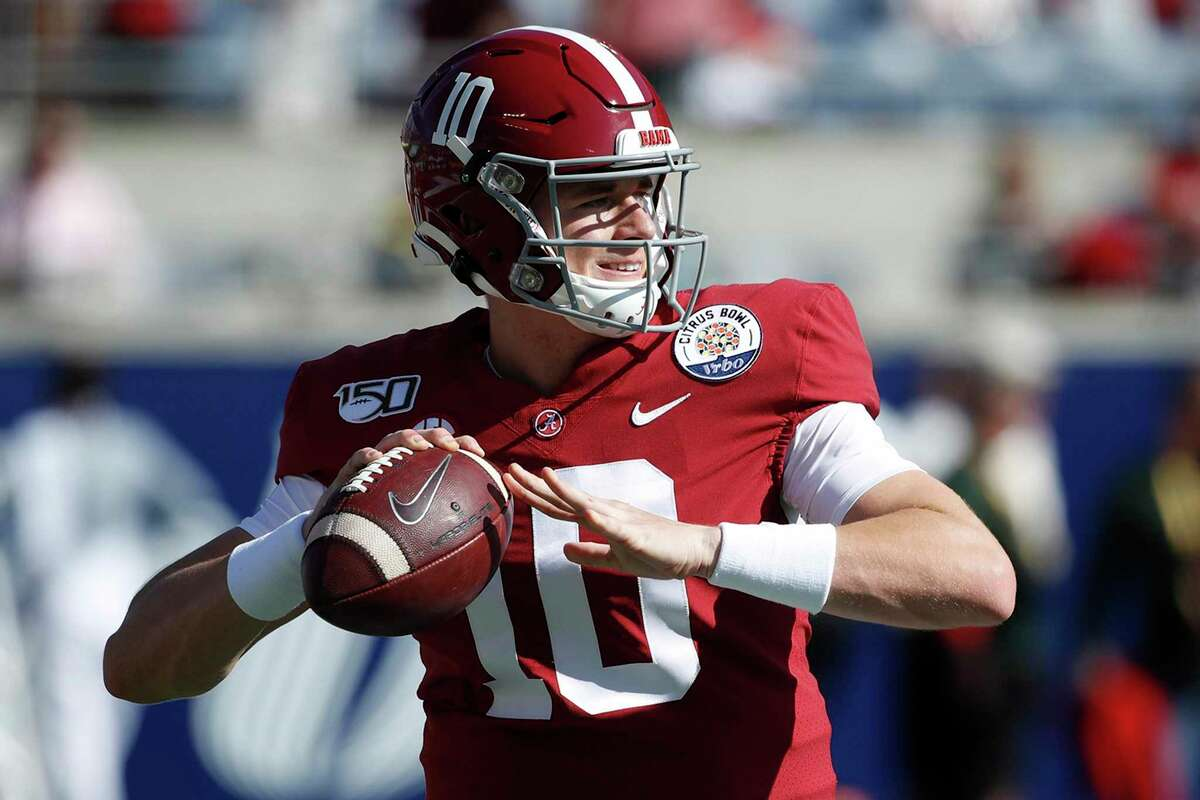Alabama's Mac Jones warms up prior to the Vrbo Citrus Bowl against Michigan in January.