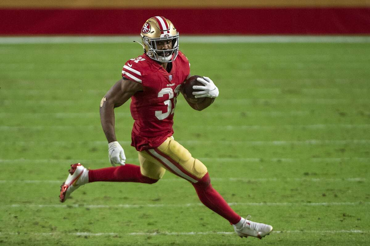 San Francisco 49ers running back Raheem Mostert (31) carries against the Washington Football Team during an NFL football game, Sunday, Dec. 13, 2020, in Glendale, Ariz. (AP Photo/Jennifer Stewart)