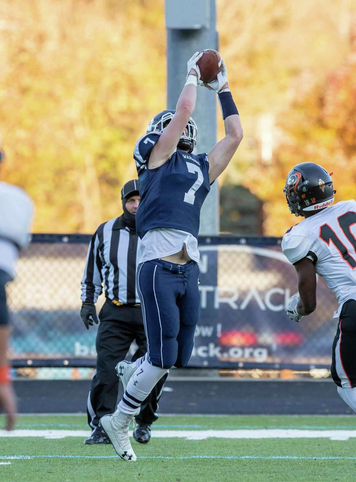 Michael Coffey snags a pass during Wilton's 42-0 homecoming win over Stamford.