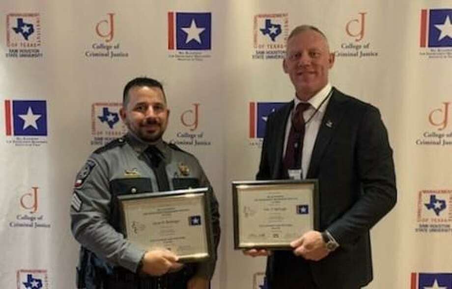 Sgts. Jesse Bullinger, left, and Eric McHugh, right, pose with their certificates from the educational training they did at Sam Houston State University. Photo: Courtesy Of The Montgomery County Precinct 4 Constable's Office