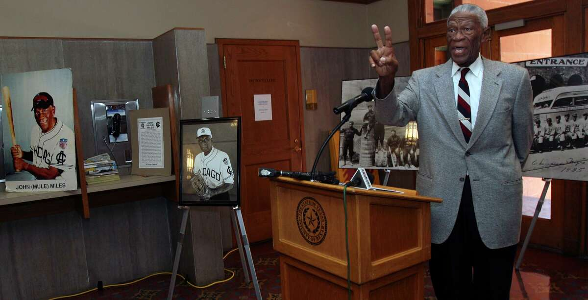 """Former Negro League baseball player John """"Mule"""" Miles,88, tells a story about a batting experience he had with baseball pitching legend Satchel Paige. Miles, a native of San Antonio, was at the Bexar County Courthouse Tuesday July 6, 2010 to highlight the opening of a traveling exhibit there called """"Discover Greatness: An Illustrated History of the Negro Baseball Leagues."""" JOHN DAVENPORT/jdavenport@express-news.net"""