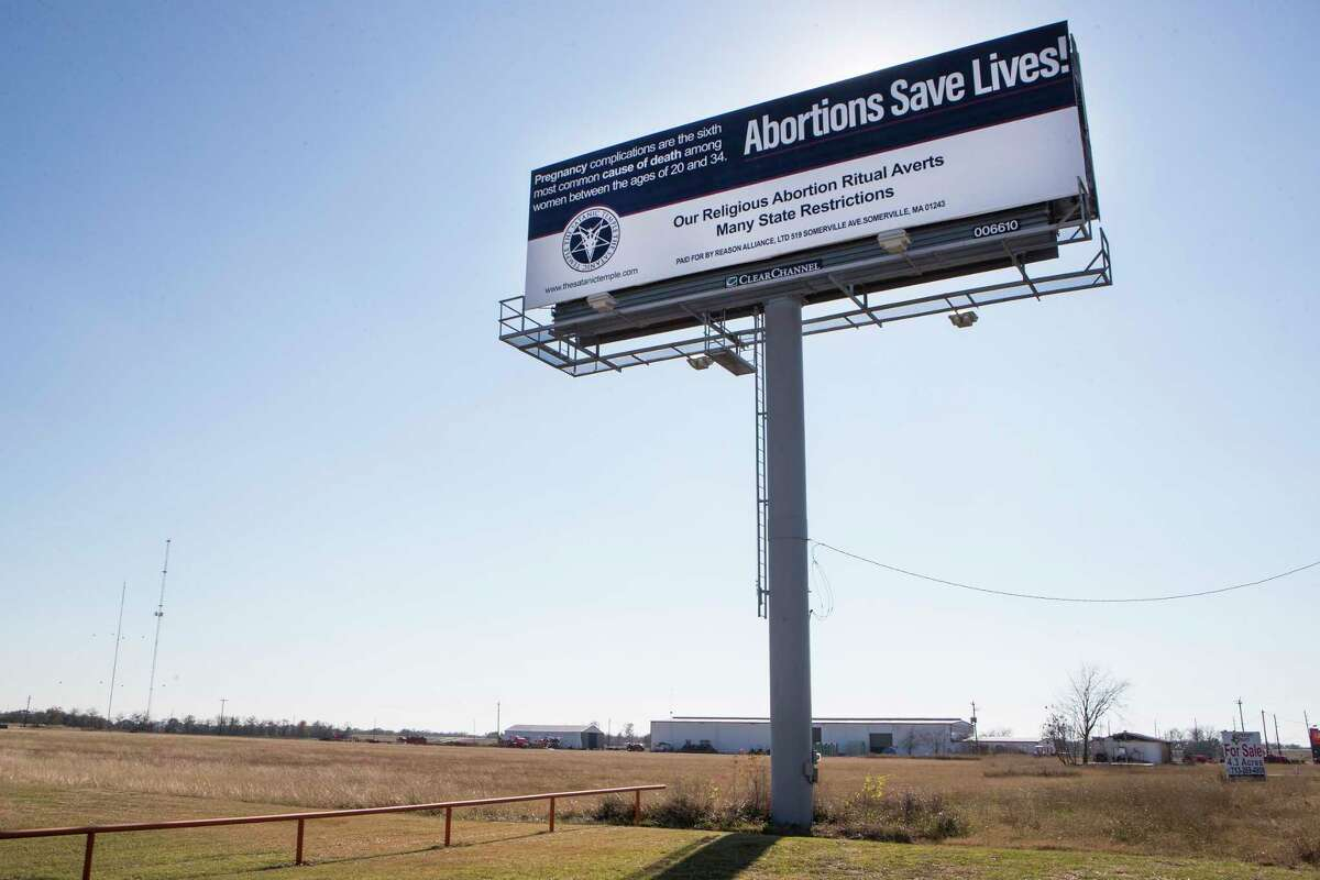 """A billboard along the US69 reads """"Abortions save lives!"""" Thursday, Dec. 17, 2020 in Rosenberg. The billboard, erected by the Satanic Temple in Houston, is one of three that the group has put up near crisis pregnancy centers in three major American cities. The billboards, which went up Dec. 14, are part of the advocacy group's protest of exemptions granted to other religions."""