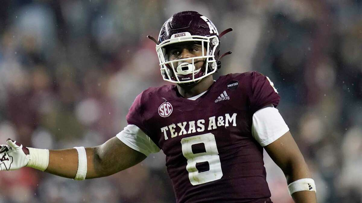 Texas A&M defensive lineman DeMarvin Leal (8) gestures towards the crowd in Kyle Filed during the first half of an NCAA college football game against LSU, Saturday, Nov. 28, 2020. in College Station, Texas. (AP Photo/Sam Craft)