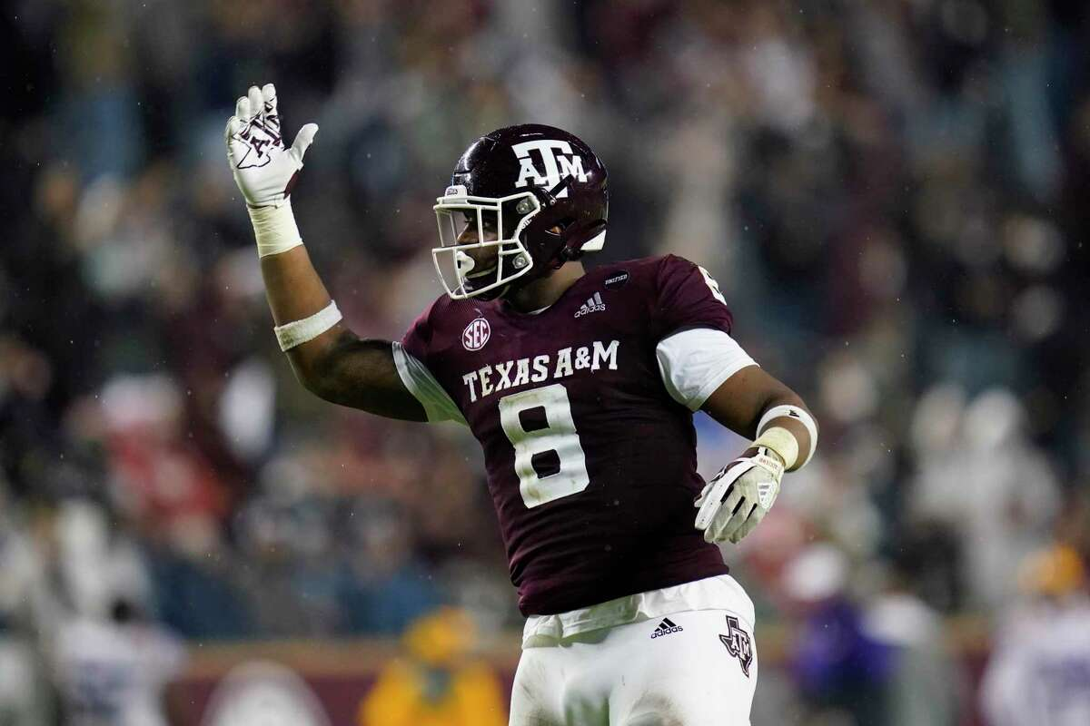 Texas A&M defensive lineman DeMarvin Leal gestures toward the crowd at Kyle Field before a third-down play by LSU during the first half of an NCAA college football game Saturday, Nov. 28, 2020. in College Station, Texas. (AP Photo/Sam Craft)