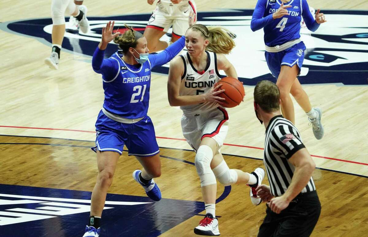 Dec 17, 2020; Storrs, Connecticut, USA; UConn Huskies guard Paige Bueckers (5) drives the ball against Creighton Bluejays guard Molly Mogensen (21) in the first half at Harry A. Gampel Pavilion. Mandatory Credit: David Butler II-USA TODAY Sports