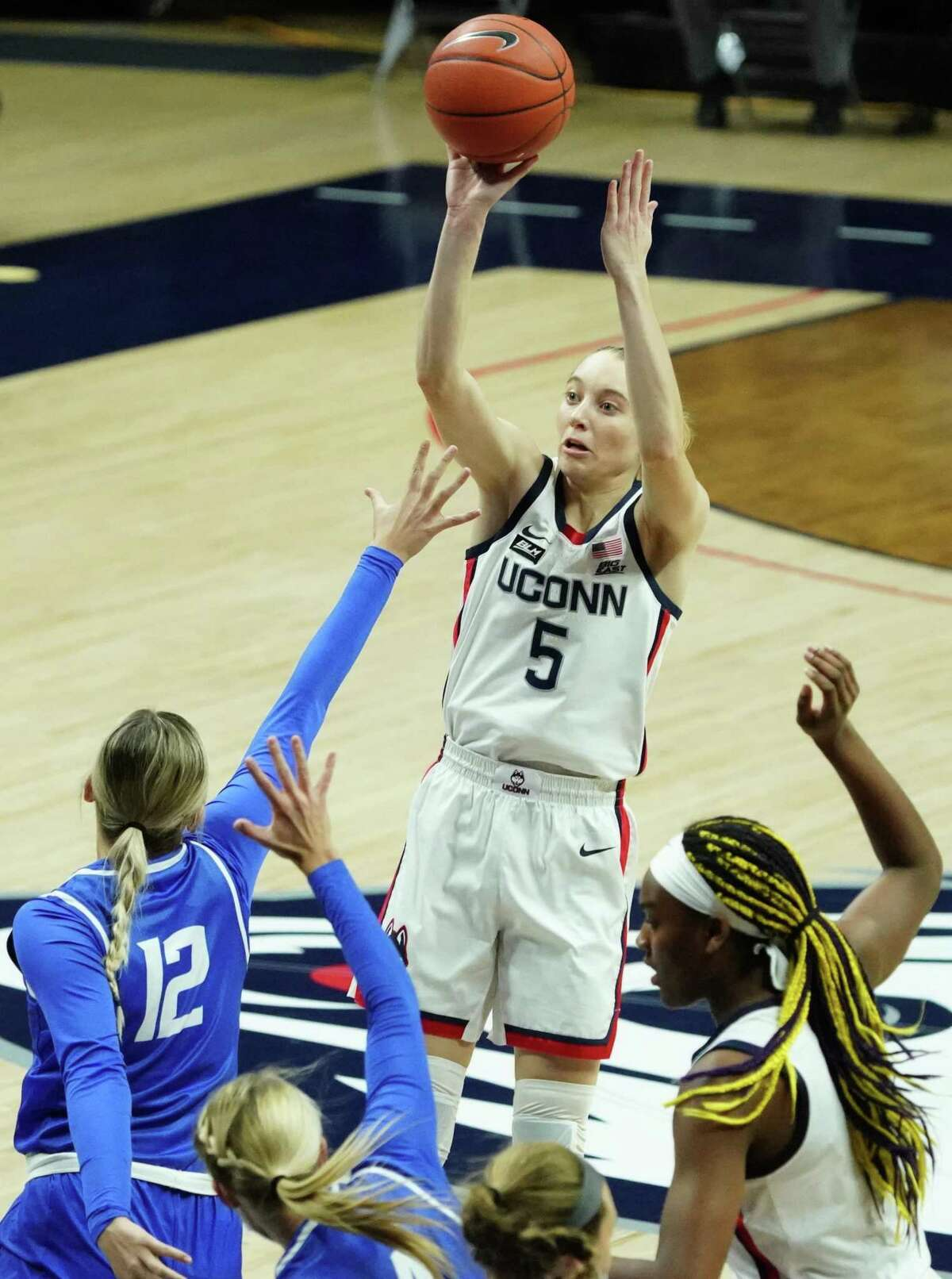 UConn's Paige Bueckers (5) shoots against Creighton's Gracey Griglione (12) in Thursday's game in Storrs.
