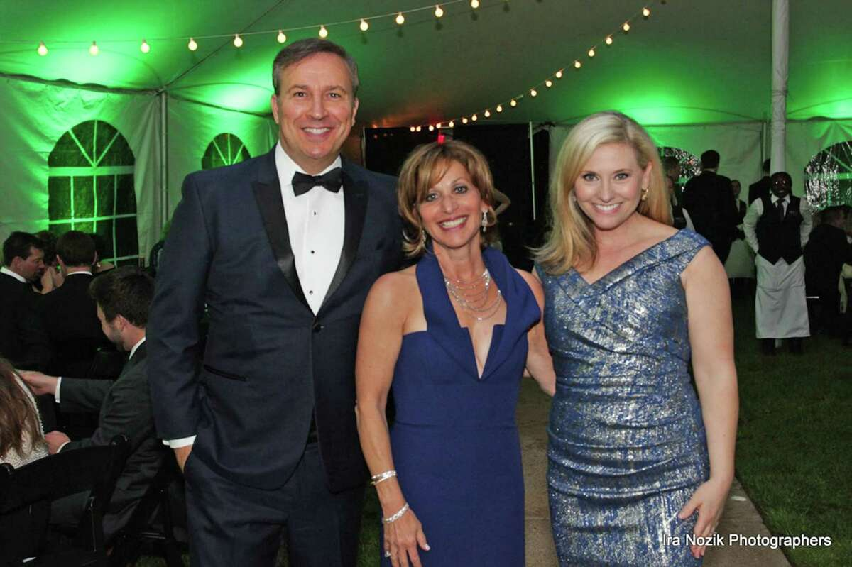 Dennis House and Kara Sundlun pose with Mayor Shari Cantor at the 19th Annual Mayor's Charity Ball last year.
