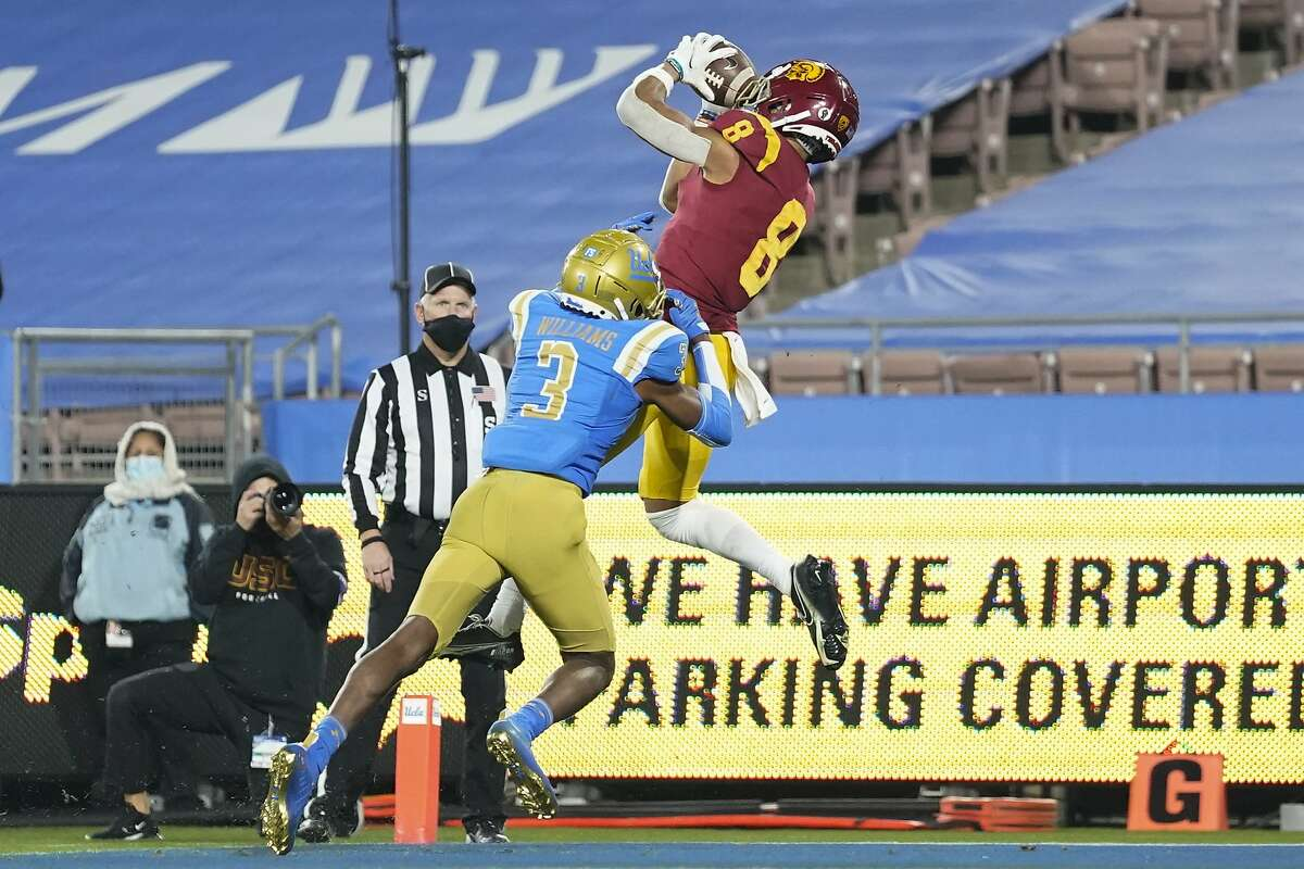 USC's Amon-Ra St. Brown hauls in a touchdown pass against UCLA last weekend. The Trojans will be looking to soar past Oregon in the Pac-12 championship game on Friday night.