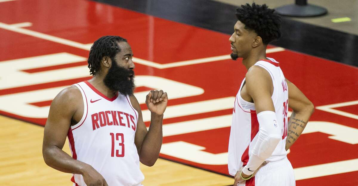 Houston Rockets guard James Harden (13) talks with forward Christian Wood (35) during a timeout in the second quarter of a preseason NBA basketball game between the Houston Rockets and the San Antonio Spurs on Thursday, Dec. 17, 2020, at Toyota Center in Houston.