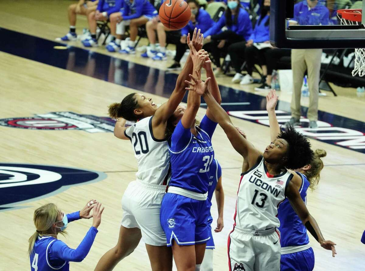 Dec 17, 2020; Storrs, Connecticut, USA; UConn Huskies forward Olivia Nelson-Ododa (20) and guard Christyn Williams (13) work for the rebound against Creighton Bluejays forward Emma Ronsiek (31) in the second half at Harry A. Gampel Pavilion. UConn defeated Creighton 80-47. Mandatory Credit: David Butler II-USA TODAY Sports