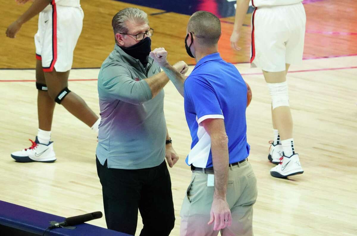 Dec 17, 2020; Storrs, Connecticut, USA; UConn Huskies head coach Geno Auriemma and Creighton Bluejays head coach Jim Flanery meet after the game at Harry A. Gampel Pavilion. UConn defeated Creighton 80-47. Mandatory Credit: David Butler II-USA TODAY Sports