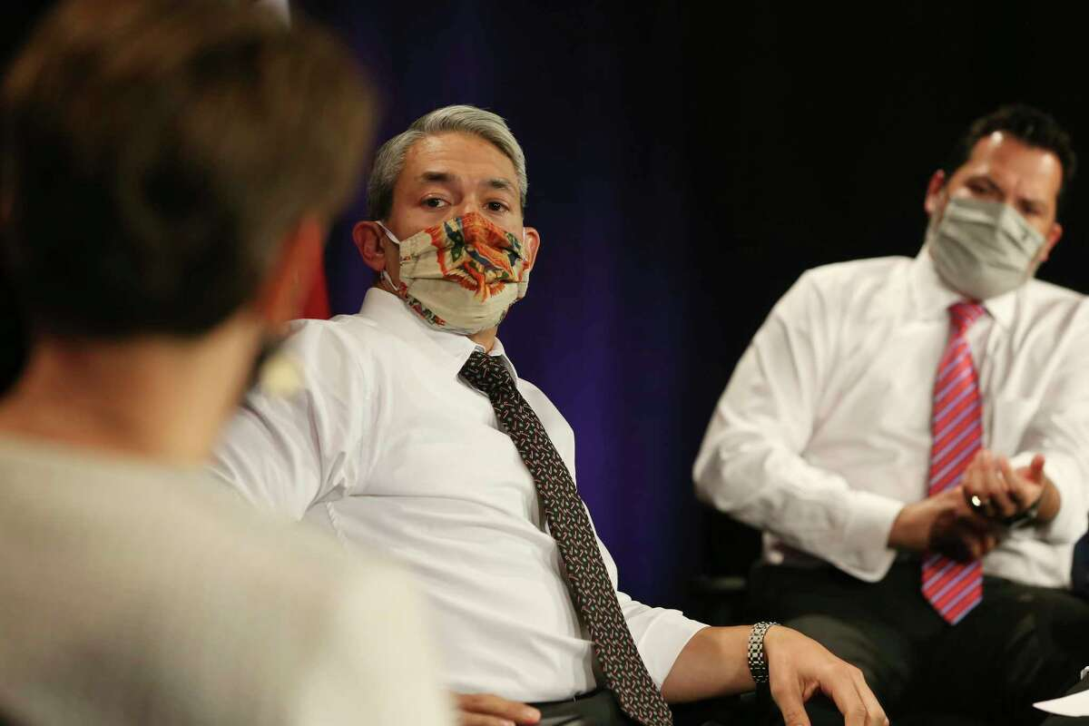 San Antonio Mayor Ron Nirenberg, center, and Bexar County Pct. 2 Commissioner Justin Rodriguez, right, talks with San Antonio Metro Health District Interim Director Colleen Bridger before the daily COVID-19 update, Thursday, Dec. 17, 2020.
