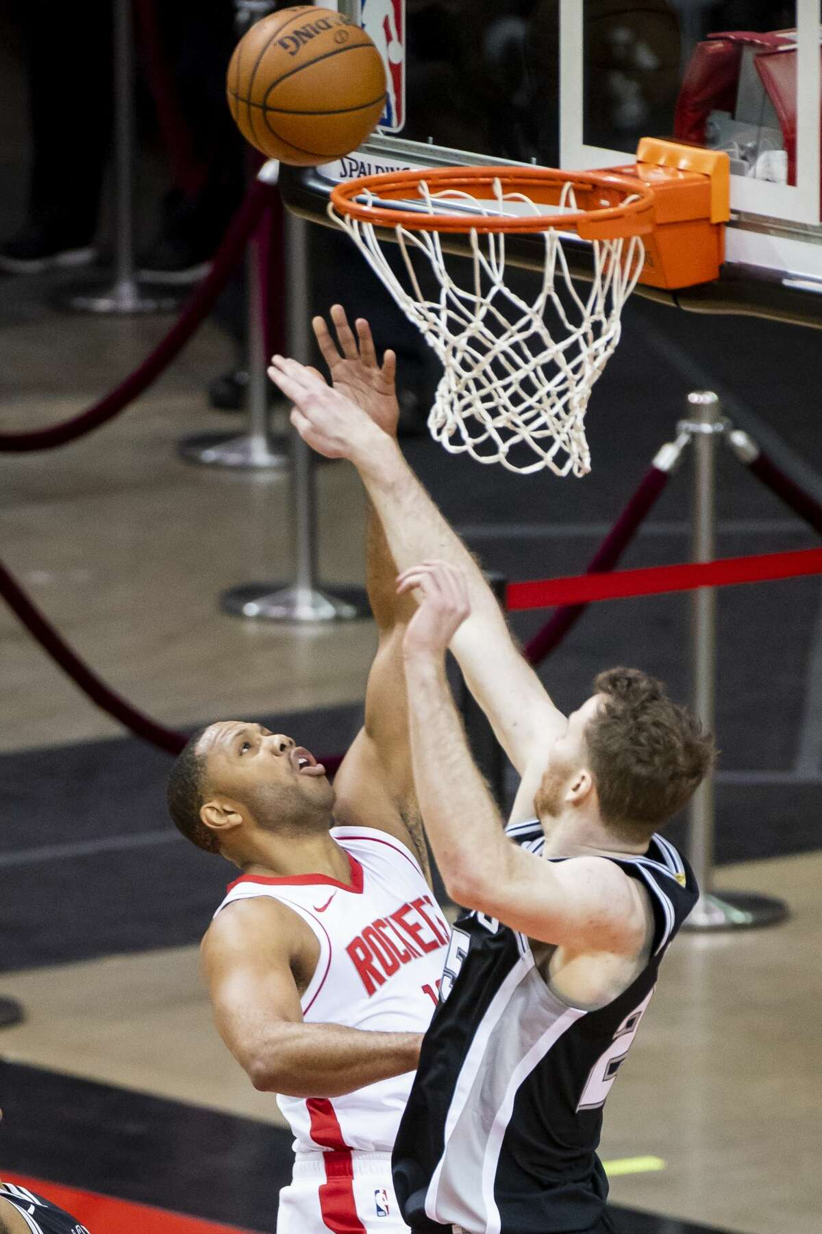 Houston Rockets guard Eric Gordon (10) shoots over San Antonio Spurs center Jakob Poeltl (25) during the third quarter of a preseason NBA basketball game between the Houston Rockets and the San Antonio Spurs on Thursday, Dec. 17, 2020, at Toyota Center in Houston.