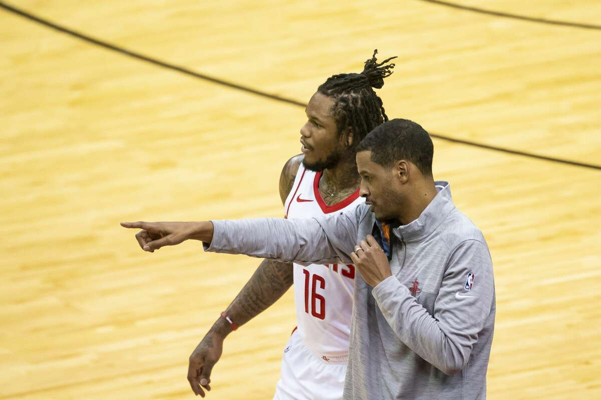"""Ben McLemore, with coach Stephen Silas last week against the Spurs, will be out for the opener to """"self isolate"""" under NBA protocols."""