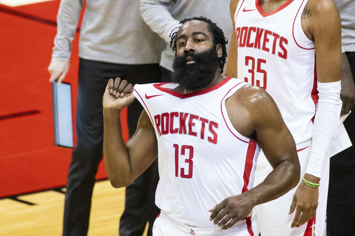 Houston Rockets guard James Harden (13) walks back to the court after a timeout during the first quarter of a preseason NBA basketball game between the Houston Rockets and the San Antonio Spurs on Thursday, Dec. 17, 2020, at Toyota Center in Houston.