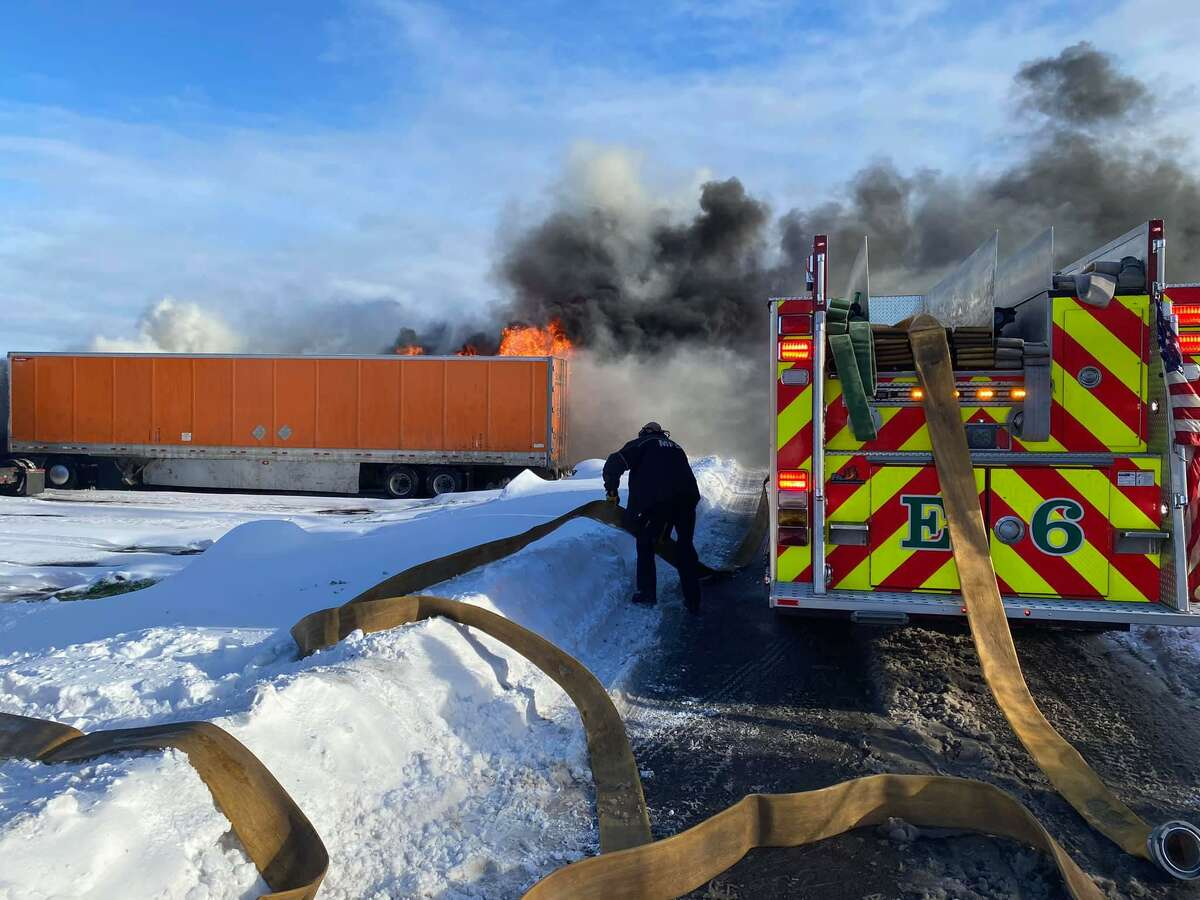Four tractor trailers were damaged and one firefighter was taken to the hospital Thursday, Dec. 17, 2020 after a fire at a truck stop in Milford, Conn. near I-95.