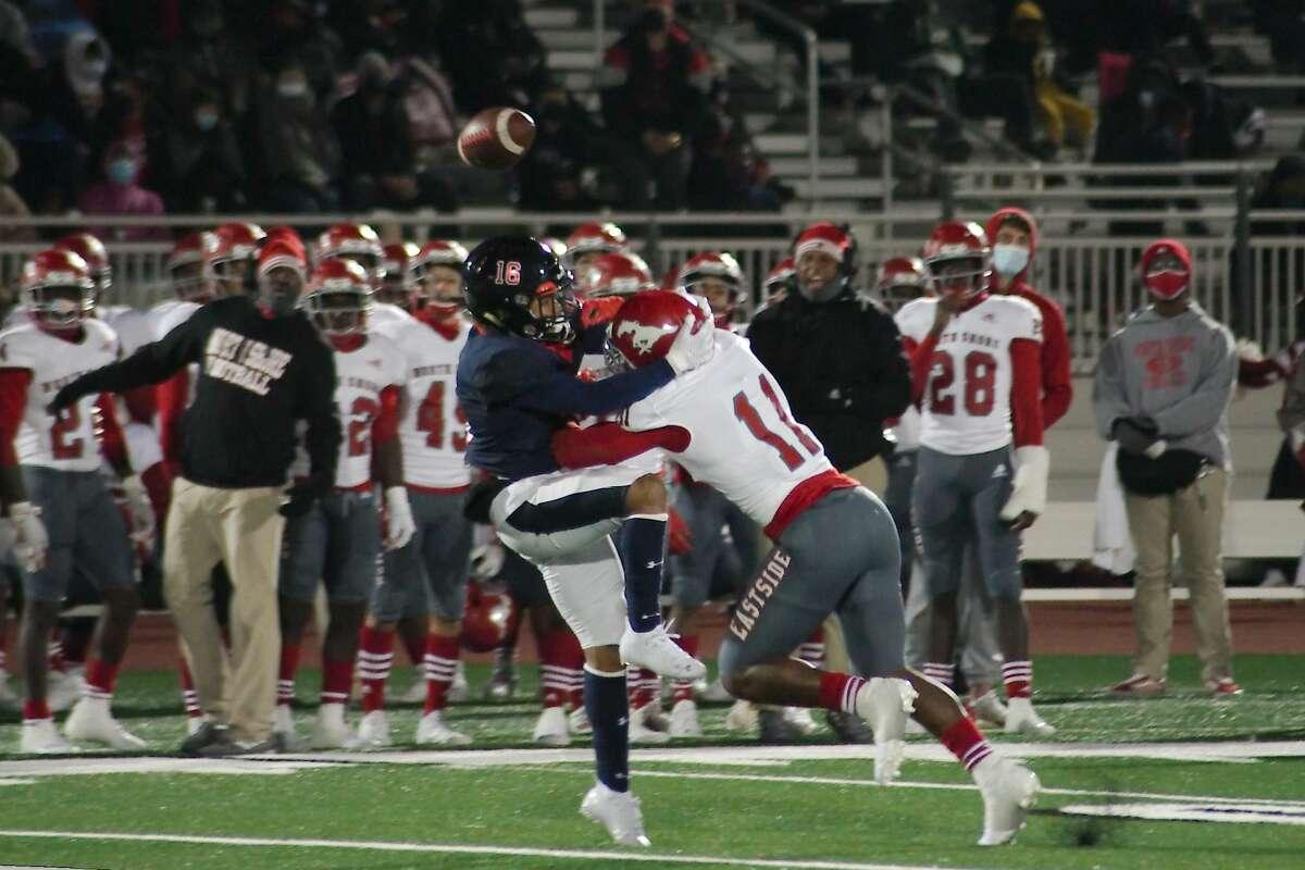 North Shore's Caleb Flagg (11) breaks up a pass to Dawson's Ashton Stroman (16) Thursday, Dec. 17 at Challenger Columbia Stadium.