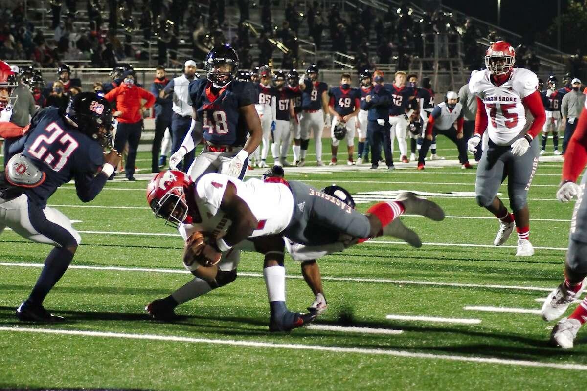 North Shore's Dematrius Davis (4) dives into the end zone for a touchdown against Dawson Thursday, Dec. 17 at Challenger Columbia Stadium.
