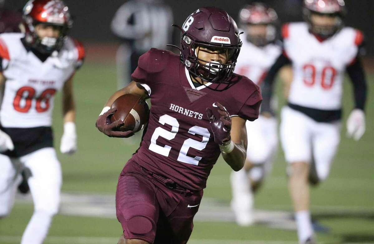 The Hornets running back Isaac Miles clear the right side for a long first quarter win when Southside takes on Flour Bluff in the high school playoffs at Alamo Stadium on December 17, 2020.